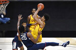 Connecticut's Josh Carlton (25) fouls Southern California's Max Agbonkpolo during the first half of an NCAA college basketball game Thursday, Dec. 3, 2020, in Uncasville, Conn. (AP Photo/Jessica Hill)
