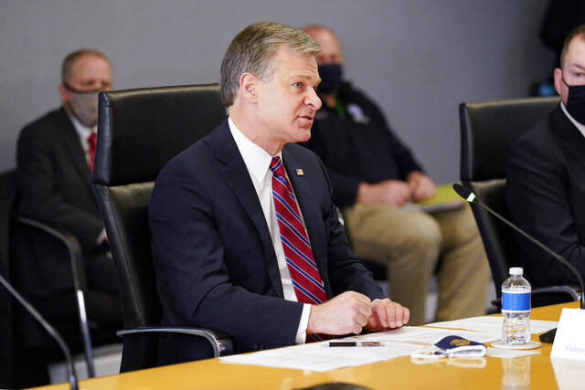 FBI Director Christopher Wray speaks during a briefing about the upcoming presidential inauguration of President-elect Joe Biden and Vice President-elect Kamala Harris, at FEMA headquarters, Thursday, Jan. 14, 2021, in Washington. (AP Photo/Alex Brandon, Pool)