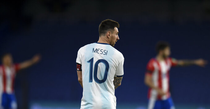 Argentina's Lionel Messi stands on the field during a qualifying soccer match against Paraguay for the FIFA World Cup Qatar 2022 in Buenos Aires, Argentina, Thursday, Nov. 12, 2020.(Marcelo Endelli, Pool via AP)