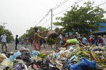"Anti-coup protesters throw garbage to block a road as a form of a ""silent protest"" in Yangon, Myanmar on Tuesday, March 30, 2021. At least 510 protesters have been killed since the coup, as of Tuesday, according to Myanmar's Assistance Association for Political Prisoners, which says the actual toll is likely much higher. (AP Photo)"