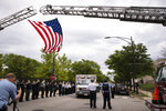 Officers salute outside the Cook County Medical Examiner's Office as an ambulance passes, containing the body of a Chicago Police officer, Tuesday, July 28, 2020, in Chicago. A high ranking member of the Chicago Police Department who was promoted earlier this month was found dead Tuesday morning after he apparently shot himself in a station on the city's West Side. An autopsy was scheduled for Wednesday at the Cook County Medical Examiner's Office on the remains of Deputy Chief Dion Boyd. (Ashlee Rezin Garcia/Chicago Sun-Times via AP)
