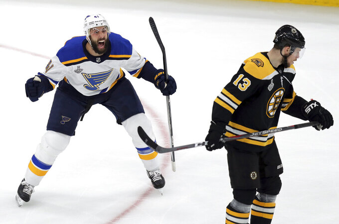 St. Louis Blues' Robert Bortuzzo, reacts beside Boston Bruins' Charlie Coyle (13) after scoring a goal during the first period in Game 2 of the NHL hockey Stanley Cup Final, Wednesday, May 29, 2019, in Boston. (AP Photo/Charles Krupa)