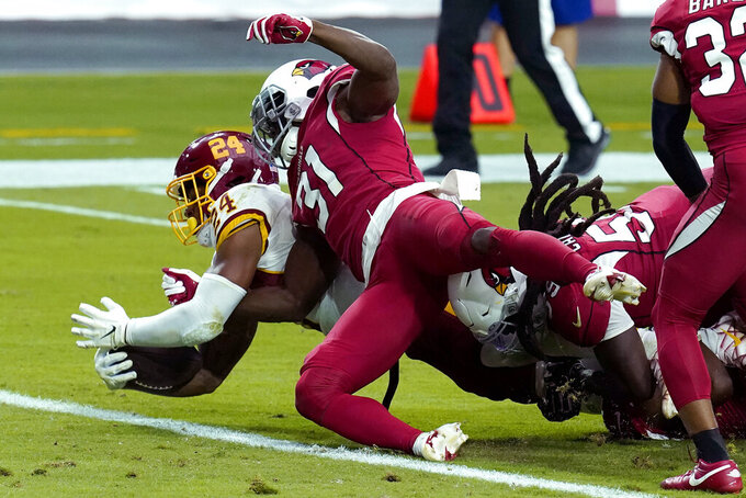 Washington Football Team running back Antonio Gibson (24) scores a touchdown as Arizona Cardinals safety Chris Banjo (31) defends during the second half of an NFL football game, Sunday, Sept. 20, 2020, in Glendale, Ariz. (AP Photo/Ross D. Franklin)