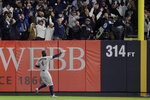 Houston Astros right fielder George Springer (4) motions as the ball, hit by New York Yankees' Aaron Hicks bounces off the foul pole for a three-run home run during the first inning of Game 5 of baseball's American League Championship Series, Friday, Oct. 18, 2019, in New York. (AP Photo/Frank Franklin II)