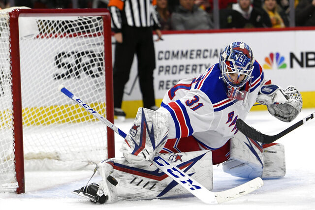 New York Rangers goalie Igor Shesterkin (31) of Russia, makes a save during the third period of an NHL hockey game against the Chicago Blackhawks Wednesday, Feb. 19, 2020, in Chicago. (AP Photo/Paul Beaty)