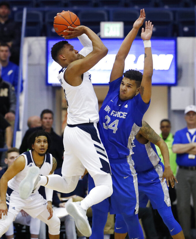 Nevada forward Tre'Shawn Thurman, left, hoists a shot over Air Force forward Ryan Swan for a basket during the second half of an NCAA college basketball game Tuesday, March 5, 2019, at Air Force Academy, Colo. Nevada won 90-79. (AP Photo/David Zalubowski)