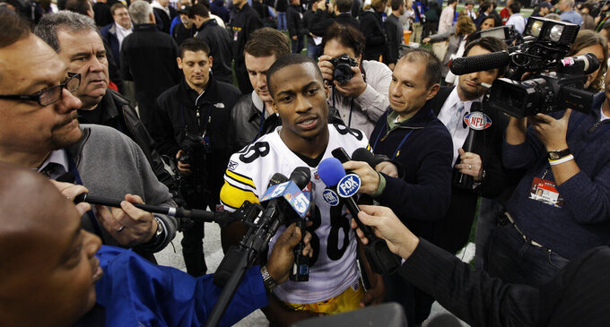 FILE - Then-Pittsburgh Steelers' Emmanuel Sanders answers questions during media day for NFL football Super Bowl XLV in Arlington, Texas, in this Tuesday, Feb. 1, 2011, file photo. New Orleans Saints first-year receiver Emmanuel Sanders is trying to reach his fourth Super Bowl with a fourth different team.(AP Photo/David J. Phillip, File)
