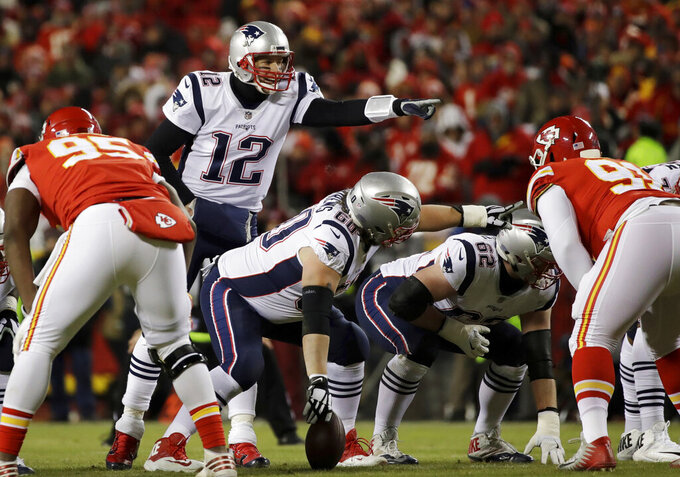 FILE - In this Jan. 20, 2019, file photo, New England Patriots quarterback Tom Brady (12) calls a play during the first half of the AFC championship NFL football game against the Kansas City Chiefs in Kansas City, Mo. We're not likely to see much of Brady until opening day. We won't see any of his buddy and standout tight end, Rob Gronkowski, whose battered body caused him to retire. It's a big blow for the 42-year-old Brady, who somehow manages to overcome such obstacles. (AP Photo/Elise Amendola, File)