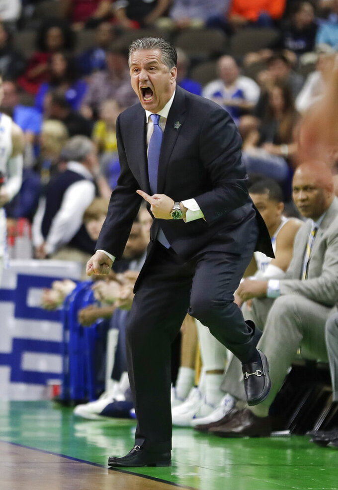 Kentucky coach John Calipari yells to his players during the first half against Abilene Christian in a first-round game in the NCAA men's college basketball tournament in Jacksonville, Fla. Thursday, March 21, 2019. (AP Photo/John Raoux)