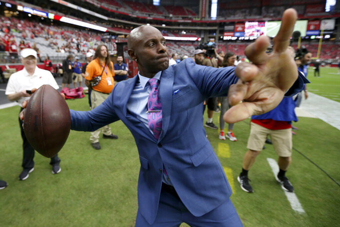 NFL hall of famer Jerry Rice throws the football prior an NFL football game between the Seattle Seahawks and the Arizona Cardinals, Sunday, Sept. 29, 2019, in Glendale, Ariz. (AP Photo/Ross D. Franklin)