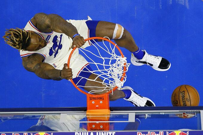 Philadelphia 76ers' Dwight Howard dunks the ball during the second half of an NBA basketball game against the Orlando Magic, Sunday, May 16, 2021, in Philadelphia. (AP Photo/Matt Slocum)