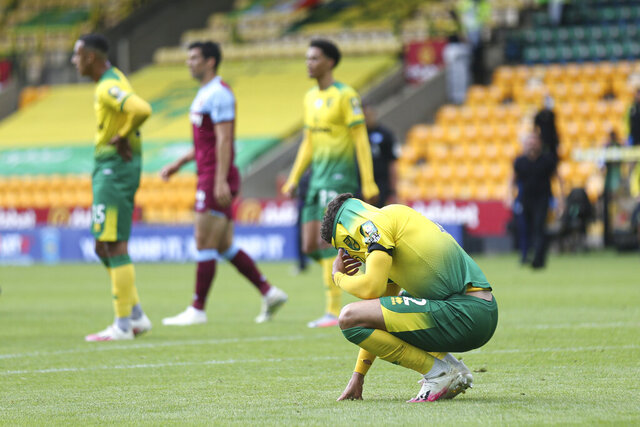 Norwich City's Max Aarons is dejected at the end of the English Premier League soccer match between Norwich City and West Ham at the Carrow Road stadium in Norwich, England, Saturday, July 11, 2020. (Alex Pantling/Pool via AP)