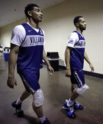 Villanova's Jermaine Samuels, left, and Phil Booth walk with ice packs on their knees after a news conference at the men's college basketball NCAA Tournament, Friday, March 22, 2019, in Hartford, Conn. Villanova faces Purdue on Saturday in the second round. (AP Photo/Elise Amendola)
