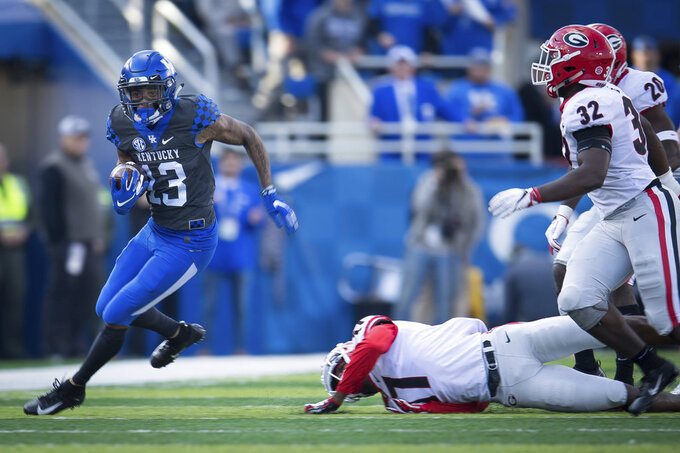Kentucky wide receiver Zy'Aire Hughes (13) during the first half an NCAA college football game against Georgia in Lexington, Ky., Saturday, Nov. 3, 2018. (AP Photo/Bryan Woolston)