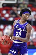 TCU's RJ Nembhard (22) controls the ball during the second half of an NCAA college basketball game against Texas Tech in Lubbock, Texas, Tuesday, March 2, 2021. (AP Photo/Justin Rex)