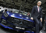 FILE - In this Wednesday, May 22, 2019 file photo, Daimler CEO Dieter Zetsche poses prior to the annual shareholder meeting of the car manufacturer Daimler in Berlin, Germany. Automaker Daimler releases second-quarter earnings on Wednesday, July 24. (AP Photo/Michael Sohn, file)