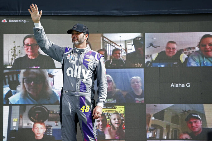 Jimmie Johnson waves to the crowd during driver introductions prior to the NASCAR Cup Series auto race at Phoenix Raceway, Sunday, Nov. 8, 2020, in Avondale, Ariz. (AP Photo/Ralph Freso)