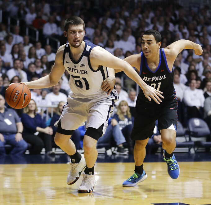 Butler's Nate Fowler (51) goes to the basket against DePaul's Flynn Cameron (21) during the first half of an NCAA college basketball game, Saturday, Feb. 16, 2019, in Indianapolis. (AP Photo/Darron Cummings)