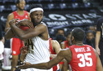 Wichita State's Morris Udeze secures a rebound in front of Houston's Fabian White Jr. during the second half of an NCAA college basketball game Thursday, Feb. 18, 2021, in Wichita, Kan. (Travis Heying/The Wichita Eagle via AP)