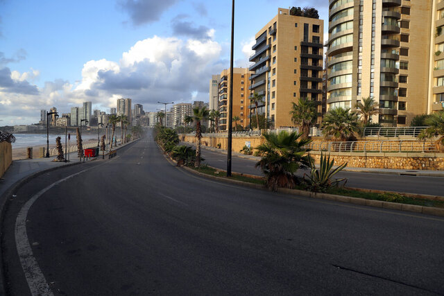 A street is empty of cars during a lockdown aimed at curbing the spread of the coronavirus, in Beirut, Lebanon, Friday, Jan. 15, 2021. Lebanon's parliament has approved a draft law to allow the importing of vaccines into the tiny country to fight the spread of coronavirus. (AP Photo/Bilal Hussein)