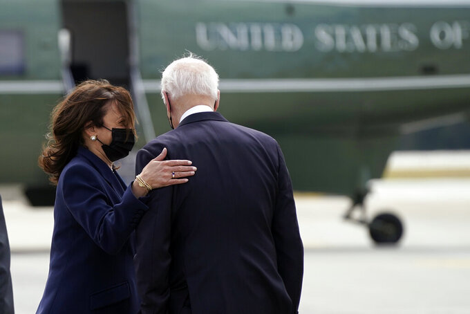 President Joe Biden talks with Vice President Kamala Harris after they arrived Friday, March 19, 2021, at Dobbins Air Reserve Base in Marietta, Ga. (AP Photo/Patrick Semansky)