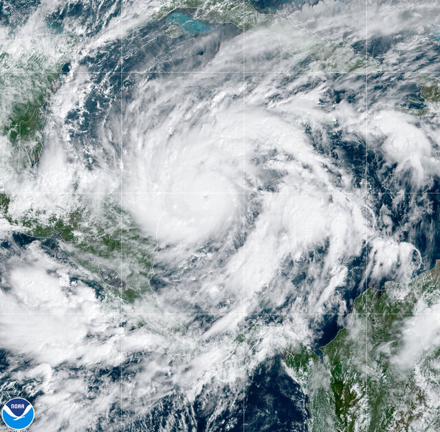 This GeoColor satellite image taken Monday, Nov. 2, 2020, at 1 p.m. EDT, and provided by NOAA, shows Hurricane Eta in the Gulf of Mexico approaching the border of Honduras and Nicaragua. New Hurricane Eta quickly gained force Monday as it headed for Central America on the verge of becoming a major hurricane, threatening massive flooding and landslides across a vulnerable region. (NOAA via AP)