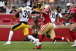 Pittsburgh Steelers free safety Minkah Fitzpatrick (39) returns a turnover against San Francisco 49ers tight end George Kittle (85) during the first half of an NFL football game in Santa Clara, Calif., Sunday, Sept. 22, 2019. (AP Photo/Tony Avelar)
