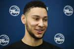 FILE - In this April 13, 2017, file photo, Philadelphia 76ers' Ben Simmons speaks with members of the media at the team's NBA basketball training facility in Camden, N.J. A person familiar with the situation says the Philadelphia 76ers and star guard Ben Simmons have agreed to a $170 million, five-year contract extension. The max deal is the latest big commitment by the team. The person spoke to The Associated Press on condition of anonymity Monday, July 15, 2019, because the contract is not official. (AP Photo/Matt Rourke, File)