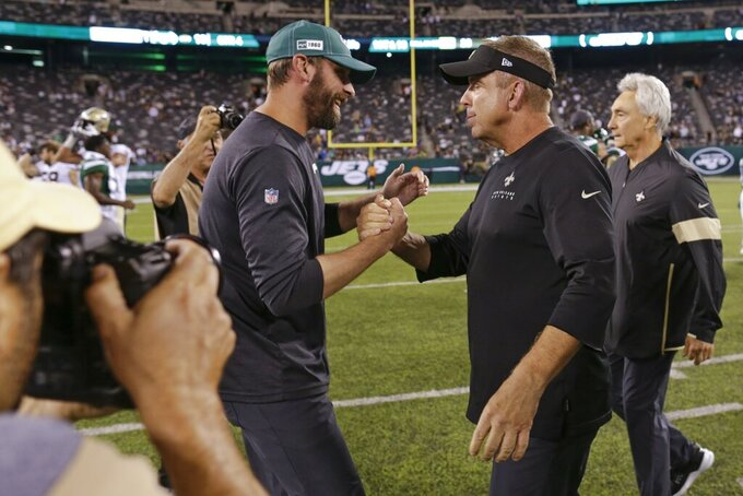 New York Jets coach Adam Gase, left, greets New Orleans Saints coach Sean Payton after a preseason NFL football game Saturday, Aug. 24, 2019, in East Rutherford, N.J. The Saints won 28-13. (AP Photo/Adam Hunger)