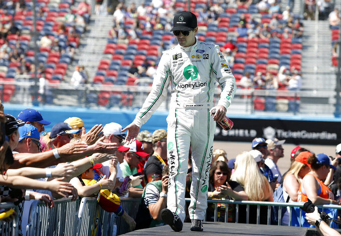 Ryan Blaney is greeted by fans during driver introductions prior to the start of the NASCAR Cup Series auto race at ISM Raceway, Sunday, March 10, 2019, in Avondale, Ariz. (AP Photo/Ralph Freso)