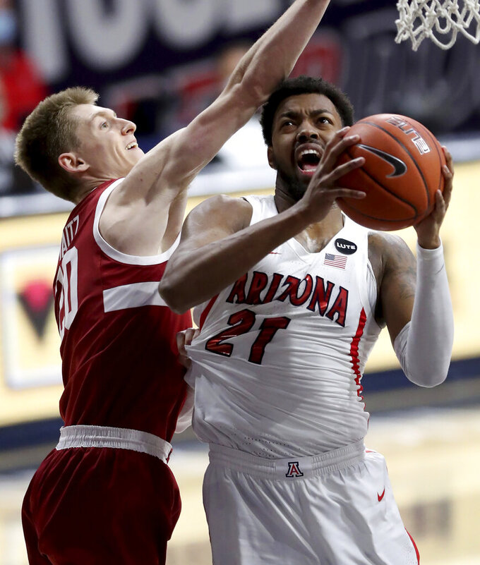 Stanford guard Noah Taitz (20) tugs on the jersey of Arizona forward Jordan Brown (21) while trying to stop his drive during the first half of an NCAA college basketball game in Tucson, Ariz., Thursday, Jan. 28, 2021. (Kelly Presnell/Arizona Daily Star via AP)