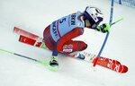 Norway's Henrik Kristoffersen speeds down the course during an alpine ski, men's World Cup slalom in Wengen, Switzerland, Sunday, Jan. 14, 2018. (AP Photo/Gabriele Facciotti)
