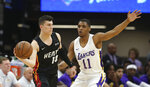 Miami Heat guard Tyler Herro, left, passes against Los Angeles Lakers guard Zach Norvell Jr. during the first half of a NBA basketball summer league game in Sacramento, Calif., Monday, July 1, 2019. (AP Photo/Rich Pedroncelli)
