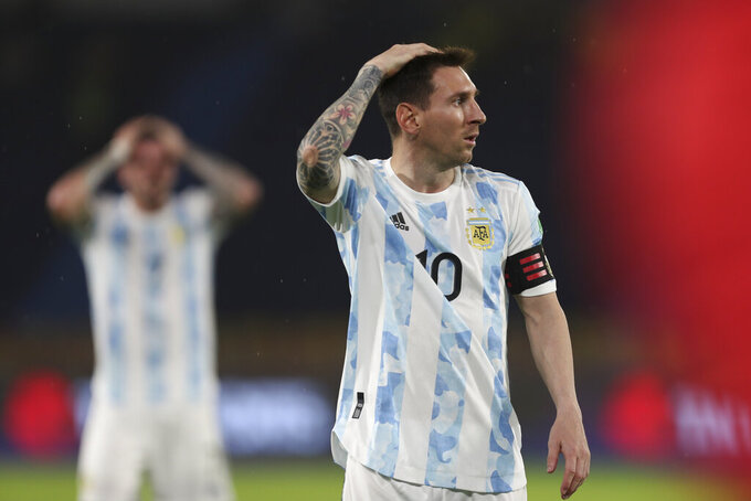 Argentina's Lionel Messi gestures during a qualifying soccer match for the FIFA World Cup Qatar 2022 against Colombia at the Metropolitano stadium in Barranquilla, Colombia, Tuesday, June 8, 2021. Miguel Borja scored an equalizer for Colombia in the last seconds of added time against Argentina in one of the best matches yet in South American qualifying. (AP Photo/Fernando Vergara)