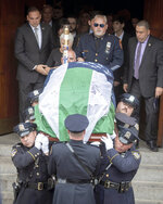 An honor guard carries the body of retired New York Police Department Detective Luis Alvarez from the Immaculate Conception Roman Catholic church in the Queens borough of New York after his funeral service on Wednesday, July, 3, 2019. Alvarez died Saturday, June 29, 2019 after a three-year battle with colorectal cancer. He attributed his illness to the three months he spent digging through rubble at the World Trade Center's twin towers after the 2001 terrorist attacks. (J. Conrad Williams Jr./Newsday via AP)