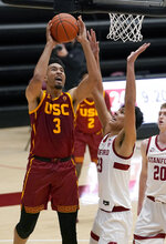 Southern California forward Isaiah Mobley (3) takes a shot over Stanford forward Brandon Angel (23) during the first half of an NCAA college basketball game in Stanford, Calif., Tuesday, Feb. 2, 2021. (AP Photo/Tony Avelar)