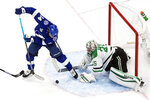 Dallas Stars goalie Anton Khudobin (35) makes a save against Tampa Bay Lightning's Pat Maroon (14) during second-period NHL Stanley Cup finals hockey action in Edmonton, Alberta, Monday, Sept. 21, 2020. (Jason Franson/The Canadian Press via AP)