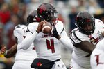 Louisville quarterback Jawon Pass (4) looks to pass during the first half of an NCAA college football game against Boston College in Boston, Saturday, Oct. 13, 2018. (AP Photo/Michael Dwyer)