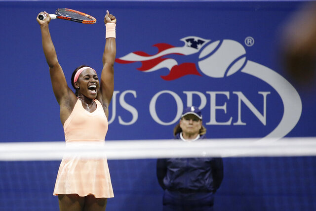 FILE - In this Sept. 7, 2017, file photo, Sloane Stephens reacts after defeating Venus Williams in a semifinal match at the U.S. Open tennis tournament in New York. The USTA says it is overseeing a commitment of more than $50 million to help the sport deal with the effects of the coronavirus pandemic. (AP Photo/Seth Wenig, File)