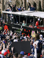 New England Patriots offensive coordinator Josh McDaniels, top left, and head coach Bill Belichick, top right, acknowledge the crowd as the Patriots parade through downtown Boston, Tuesday, Feb. 5, 2019, to celebrate their win over the Los Angeles Rams in Sunday's NFL Super Bowl 53 football game in Atlanta. (AP Photo/Steven Senne)