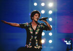This image released by CBS shows Bruno Mars during a taping of his first primetime television special,