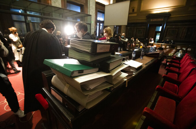 Stacks of documents are placed on a table at the start of a hearing, European Commission vs AstraZeneca, at the main courthouse in Brussels, Wednesday, May 26, 2021. The European Union took on vaccine producer AstraZeneca in a Brussels court on Wednesday with the urgent demand that the company needs to make an immediate delivery of COVID-19 shots the 27-nation bloc insists were already due. (AP Photo/Virginia Mayo)