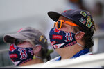 Boston Red Sox fans watch a spring training baseball game between Red Sox and Atlanta Braves, Tuesday, March 16, 2021, in Fort Myers, Fla. (AP Photo/John Bazemore)