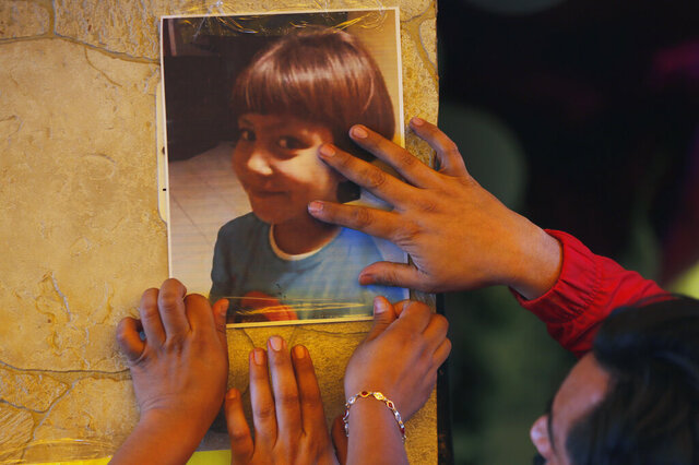 Relatives post a photo of Fatima, a 7-year-old girl who was abducted from the entrance of the Enrique C. Rebsamen primary school and later murdered, at her home in Mexico City, Monday, Feb. 17, 2020. The girl's body was found wrapped in a bag and abandoned in a rural area on Saturday and was identified by genetic testing. (AP Photo/Marco Ugarte)