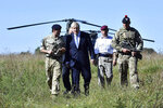 "Britain's Prime Minister Boris Johnson arrives in a chinook helicopter to visit military personnel on Salisbury Plain training area near Salisbury, England, Thursday, Sept. 19, 2019. British Prime Minister Boris Johnson was accused by a one of the country's former leaders of a ""conspicuous"" failure to explain why he suspended Parliament for five weeks, as a landmark Brexit case at the U.K. Supreme Court came to a head on Thursday. (Ben Stansall/Pool Photo via AP)"