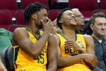 Baylor guard Davion Mitchell (45) and guard Jared Butler (12) laugh on the bench in the final minutes of the team's NCAA college basketball game against Tennessee-Martin Thursday, Dec. 19, 2019, in Houston. (AP Photo/Michael Wyke)