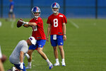 New York Giants quarterback Eli Manning passes in front of quarterback Daniel Jones during an NFL football practice Monday, May 20, 2019, in East Rutherford, N.J. (AP Photo/Adam Hunger)