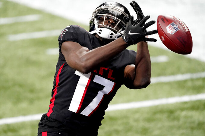 Atlanta Falcons wide receiver Olamide Zaccheaus (17) misses a catch in the end zone against the Las Vegas Raiders during the first half of an NFL football game, Sunday, Nov. 29, 2020, in Atlanta. (AP Photo/John Bazemore)