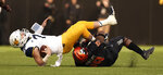 Oklahoma State linebacker Justin Phillips (19) sacks West Virginia quarterback Will Grier (7) during the first half of an NCAA college football game in Stillwater, Okla., Saturday, Nov. 17, 2018. (AP Photo/Brody Schmidt)