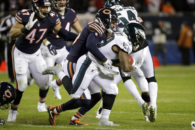 Chicago Bears defensive back DeAndre Houston-Carson (36) tackles Philadelphia Eagles running back Boston Scott (49) during the second half of an NFL wild-card playoff football game Sunday, Jan. 6, 2019, in Chicago. (AP Photo/Nam Y. Huh)